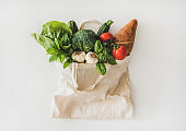 Online grocery healthy food shopping in eco-friendly bag, top view