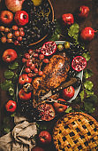 Flat-lay of roasted duck, apple pie and fruits for Thanksgiving