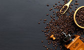 coffee bean and hand grinder on black table background. space for text. top view