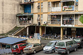 The balconies of an apartment building are hung with clothes. The poor area. Moments of Ordinary Life