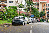 Cars parked on the sidelines in a row. Street in Malaysia. Kuala Lumpur , Malaysia - 05.27.2020