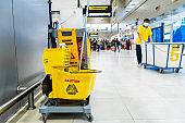 A set of tools and plates for mopping at the airport. Yellow bucket plates and brushes. Cleaning Service