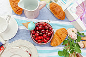 Summer picnic with ripe cherries and ice cream