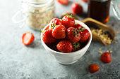 Fresh strawberry in a white bowl