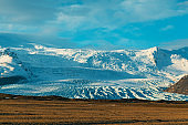 Incredible Icelandic landscapes. Snow-capped mountains and glacier. Sunset.
