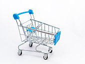 Mini empty grocery cart isolated on white background.