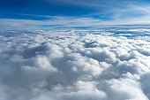 Fluffy clouds top view of the airplane. Heavenly landscape