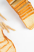 Sliced toast bread on a white background. Top view, flat lay