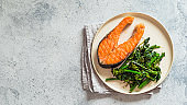 Ready-to-eat grilled salmon steak and greens