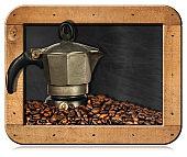 Italian Coffee Maker and Coffee Beans in a blackboard