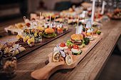 Different species of canapes appetizers on table