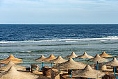Red Sea beach with straw umbrellas - Marsa Alam Egypt Africa