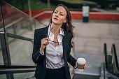 Business lady on coffee break in city