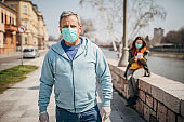 People with protective mask on the street in safe distance