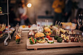 Beautifully arranged canapes appetizers on table