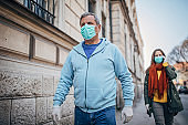 People with protective mask walking on the street in safe distance