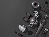 Camera and accessories on black, copy space
