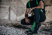 Male in combat boots in abandoned building