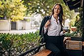 Beautiful lady on coffee break in cafe outdoors
