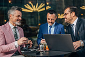 Three businessmen having a meeting in cafe