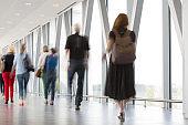 Group of People Walking on Modern Hallway, Motion Blur Effect