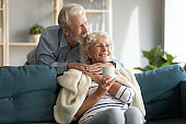 Affectionate senior married couple enjoying sweet tender cozy moment.
