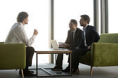 Candidate answering smiling hr managers questions in job interview