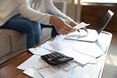 Close up of woman manage household finances at home