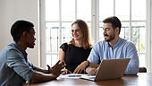 African American manager consulting smiling couple at meeting