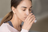 Close up cropped image of millennial girl drinking pure water.