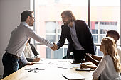 Negotiation starts with leaders of business parties shaking hands
