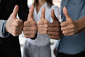 Diverse business team people hands showing thumbs up.
