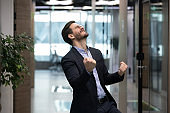 Successful businessman feels overjoyed celebrate career advancement