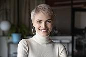 Head shot profile portrait blonde businesswoman in modern office.