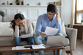 Distressed couple worried about bankruptcy paying bills online