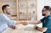 Male employer handshake job applicant greeting with employment