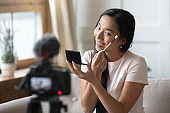 Beautiful young asian female blogger recording video.