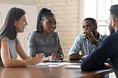 Multiethnic employees talk discussing ideas at meeting