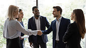 Diverse businesspeople handshake getting acquainted in office