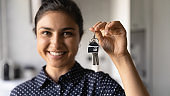 Happy young indian female excited about buying apartment of dream