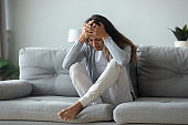 Depressed female crying suffer from depression at home