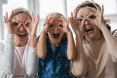 Portrait of happy three generations of women having fun