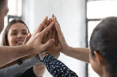 Diverse businesspeople engaged in teambuilding activity in office