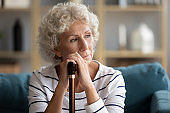 Pondering stressed disabled woman thinking of health problem.
