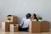 African American couple in new apartment looking at copy space