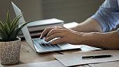 Close up of man tying on modern laptop keyboard