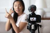 Close up professional camera recording young vietnamese woman.