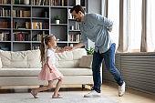 Gentleman father invites on dance little princess daughter