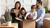 Excited family with little kids settle at new home