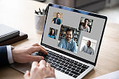 Male employee have webcam conference with diverse colleagues